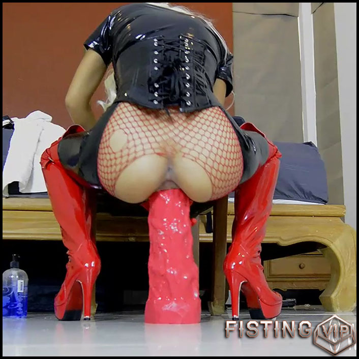 Big Tits Rubber Queen Rides On A Shocking Red Dildo - Monster Dildo